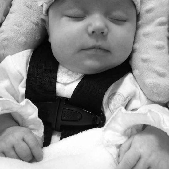 Newborn baby in car seat