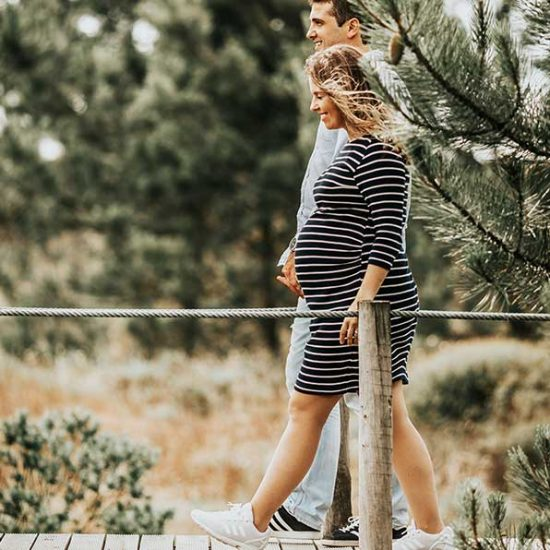 Pregnant couple going for a walk to induce labour
