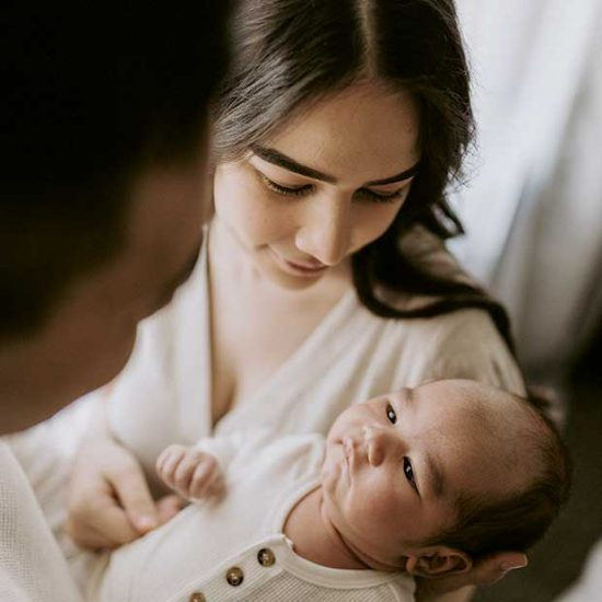 Mum and Dad with newborn baby postpartum