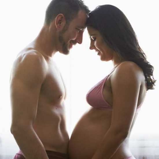 Pregnant couple getting intimate