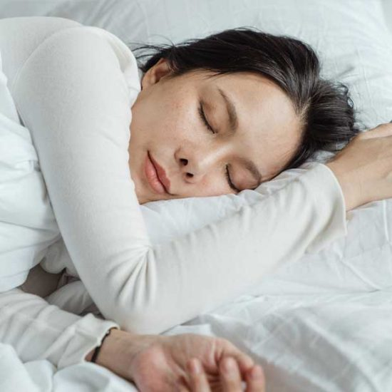 Woman going to sleep in bed