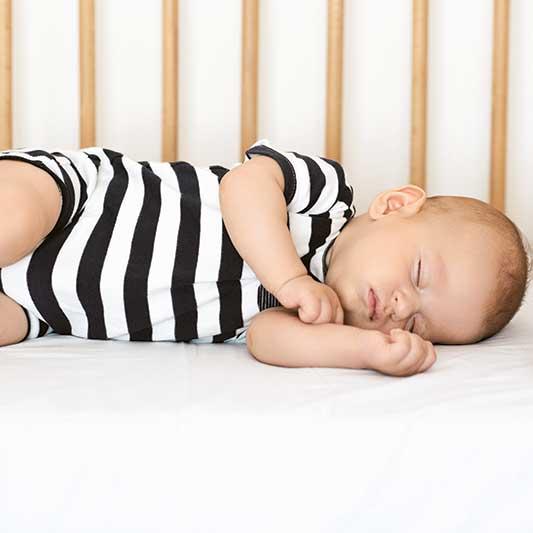 12 week old baby sleeps in cot