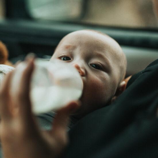 Baby having bottle of formula