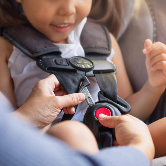 Toddler bucked into car seat