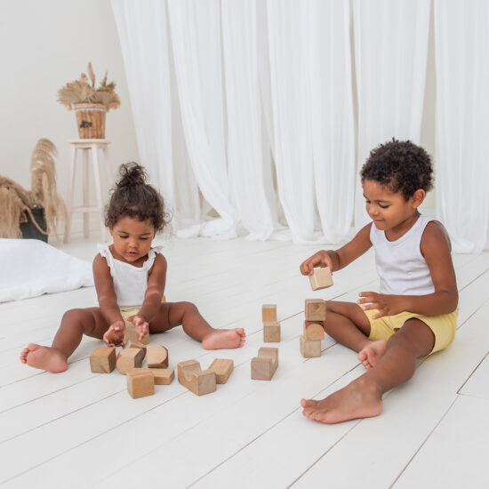 Children sitting on the floor playing with blocks