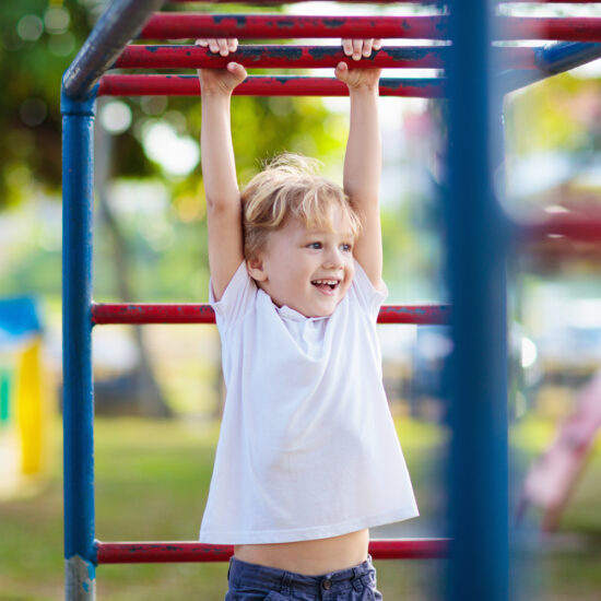Child playing on monkey bars at daycare